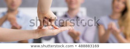 小さな 耳が聞こえない 人 手話を ソファ 家族 ストックフォト © AndreyPopov