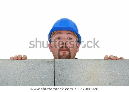 Builder peering over wall Stock photo © photography33