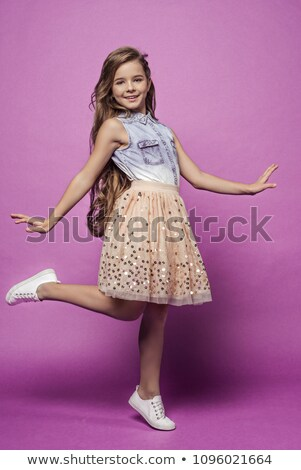 beautiful young blonde in denim skirt isolated stock photo © acidgrey