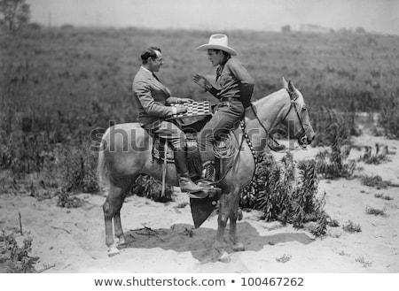 дружественный Cowboy бизнесмен складе фото Сток-фото © dgilder