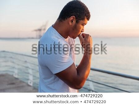 Poważny Afryki człowiek sportowiec cień Zdjęcia stock © deandrobot