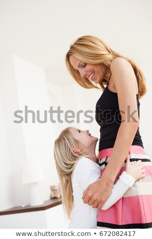 mother and daughter hugging eachother Stock photo © IS2