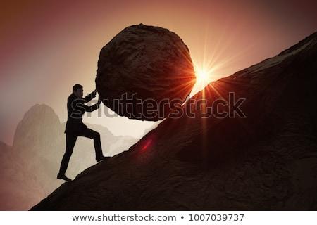 Man pushing boulder Stock photo © IS2