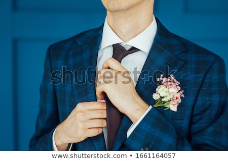 Latin man wearing a tie at morning wedding preparation stock photo © ruslanshramko