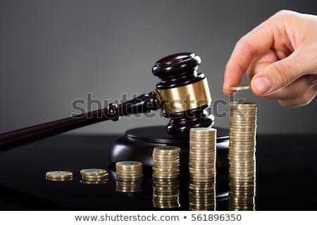 Richter halten gestapelt Münzen Hand Stock foto © AndreyPopov