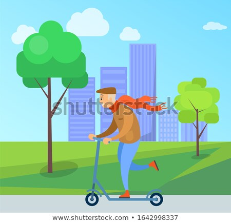 Old Man With Red Scarf Riding Scooter in Park Stock photo © robuart