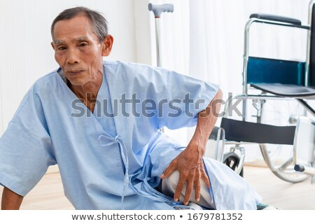 disabled man fallen down from wheelchair stock photo © andreypopov