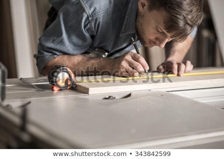 Сток-фото: Carpenters Measuring Wooden Board At Workshop