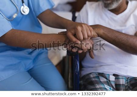 молодые афроамериканец женщины врач старший Сток-фото © wavebreak_media