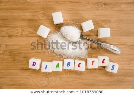 Close-Up shot of natural brown refined sugar cubes on white background. Stock photo © DenisMArt