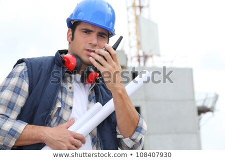Tradesman speaking into a walkie talkie Stock photo © photography33