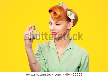 Beautiful attractive woman with luxury make-up, perfume smell, eyes closed Stock photo © Geribody