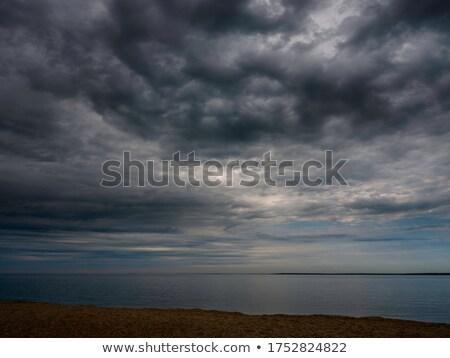 Puesta de sol tempestuoso mar vacío playa rayos de sol Foto stock © mahout