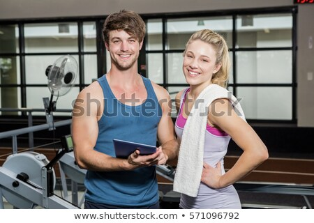 Foto stock: Portrait of trainer and woman standing with digital tablet