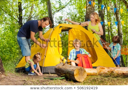 Boy and girl putting up tent Stock photo © IS2