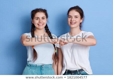 imagem · otimista · casal · casual · desgaste · sorridente - foto stock © deandrobot