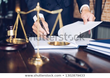 Gavel on wooden table and home loan insurance with agreement in  Stock photo © Freedomz