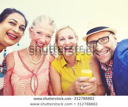 Groep gelukkig senior vrienden lachend ander Stockfoto © wavebreak_media