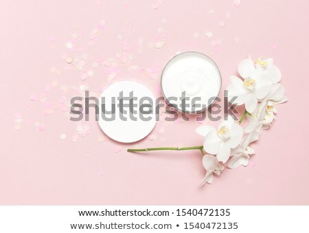 Luxury face cream moisturizer for facial skin on pink flower bac Stock photo © Anneleven