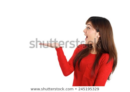 Happy smiling woman presenting placeholder on white background Stock photo © wavebreak_media