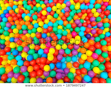 Green and orange plastic kids spade Stock photo © lucielang
