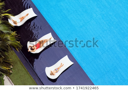 Chaise lounges in swimming pool, Thailand Stock photo © nuiiko