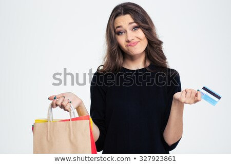 Woman spent all money from the bank card Stock photo © deandrobot