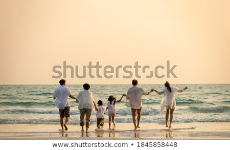 Grandfather with children on sunset at sea stock photo © Paha_L