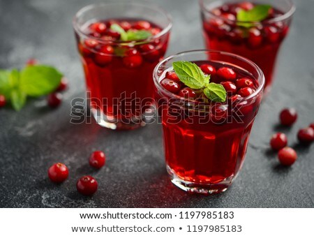 Glass of cranberry juice on concrete background Stock photo © vankad