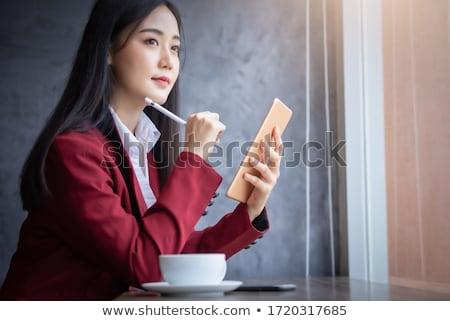 Businesswoman using digital tablet on table in cafe Stock photo © wavebreak_media