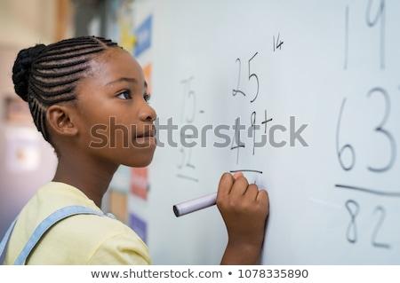 Stockfoto: Meisje · leren · schrijven · nummers · primair · klasse