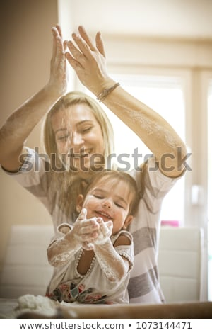 mother and daughter making cookies with molds stock photo © andreypopov