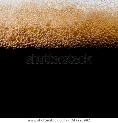 Karanlık bira cam köpük yalıtılmış beyaz Stok fotoğraf © limpido