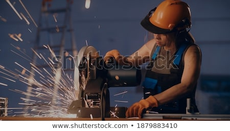 Woman with an electric saw Stock photo © photography33