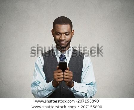 Primo piano uomo guardare telefono cellulare business mano Foto d'archivio © photography33