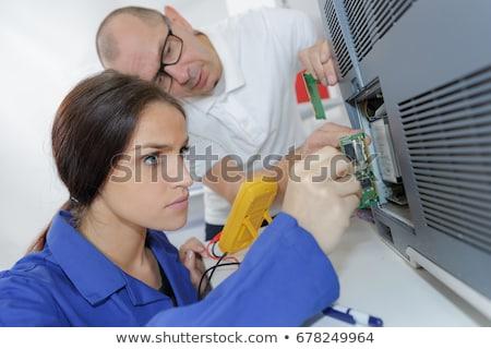 Eletricista feminino aprendiz edifício homem indústria Foto stock © photography33