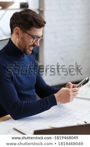 confident engineer with a phone stock photo © photography33