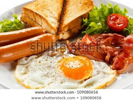 Tojások hotdog reggeli közelkép tányér sekély Stock fotó © milsiart