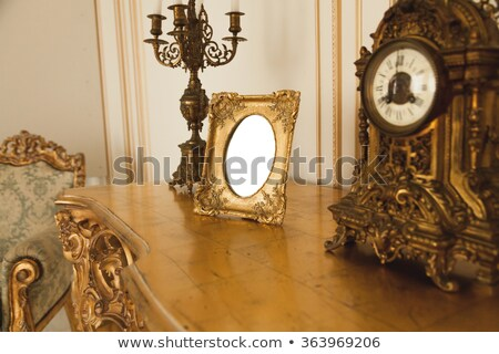 golden table clock with photo frame Stock photo © ozaiachin