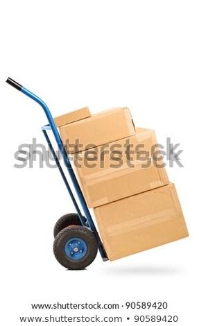Relocation - Cardboard Box on Hand Truck. Stock photo © tashatuvango