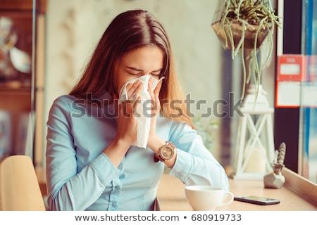woman sneezing stock photo © hofmeester
