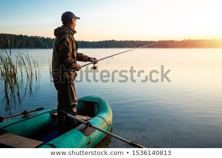 fisherman fishing at dawn stock photo © oleksandro