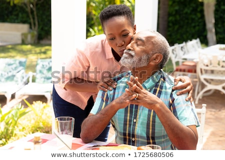 Smiling woman interacting during lunch Stock photo © wavebreak_media