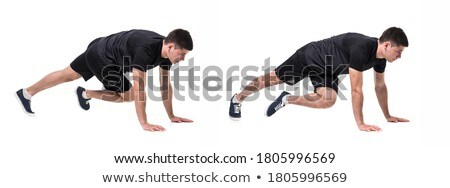 Portrait of a concentrated sportsman doing plank Stock photo © deandrobot