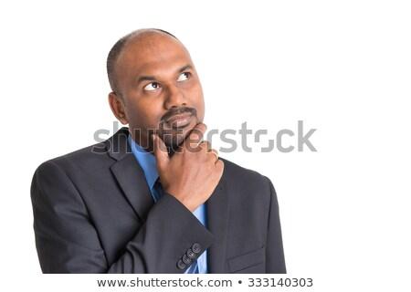 portrait of confident handsome businessman thinking on black background stock photo © traimak