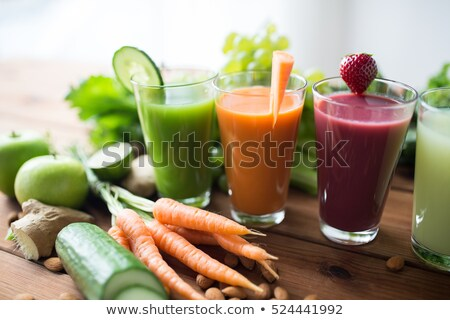 Stock photo: glasses with different fruit or vegetable juices