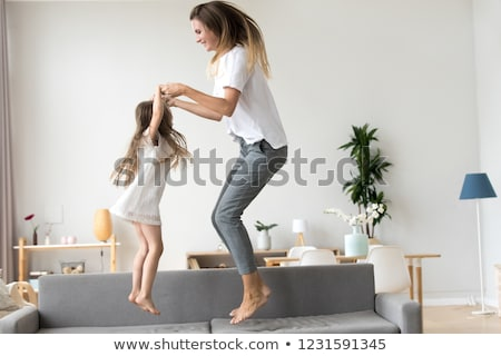 Positive young family with little baby girl spending time together Stock photo © deandrobot
