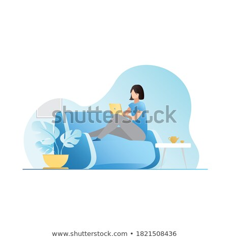 Business woman using tablet in a cozy environment Stock photo © ra2studio