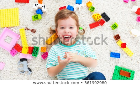 happy child girl laughing and playing with toys constructor BANNER, LONG FORMAT Stock photo © galitskaya