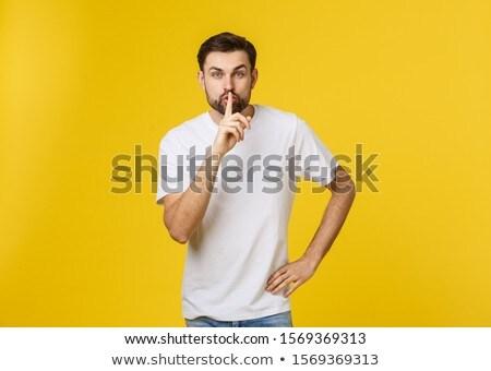 молодым человеком молчание жест изолированный желтый Сток-фото © benzoix